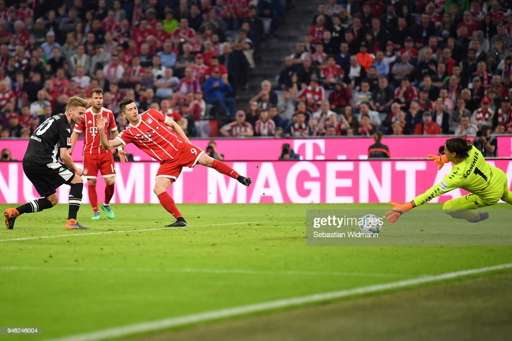 Robert Lewandowski of Bayern Muenchen (9) shoes a goal to make it 5:1 during the Bundesliga match between FC Bayern Muenchen and Borussia Moenchengladbach at Allianz Arena on April 14, 2018 in Munich, Germany.
