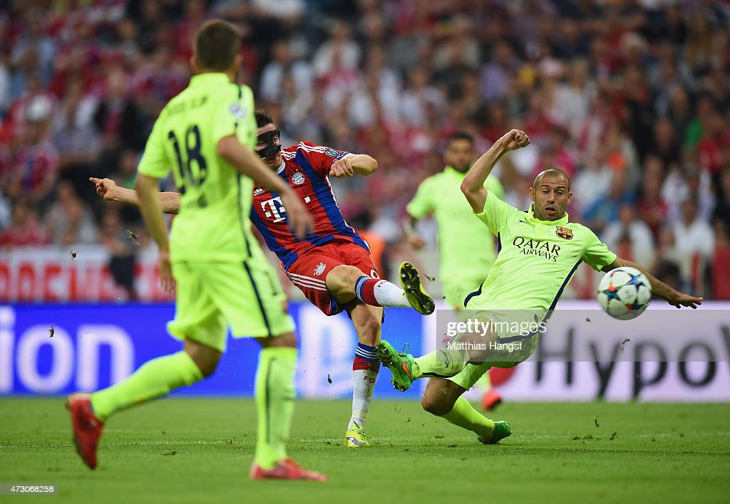 Robert Lewandowski of Bayern Muenchen shoots past Javier Mascherano of Barcelona to score their second goal during the UEFA Champions League semi final second leg match between FC Bayern Muenchen and FC Barcelona at Allianz Arena on May 12, 2015 in Munich, Germany.