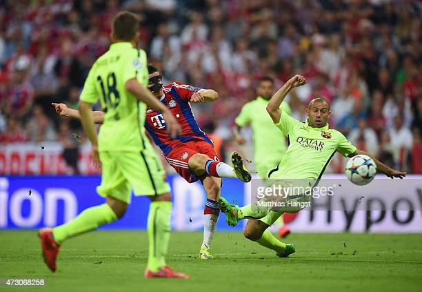 Robert Lewandowski of Bayern Muenchen shoots past Javier Mascherano of Barcelona to score their second goal during the UEFA Champions League semi...