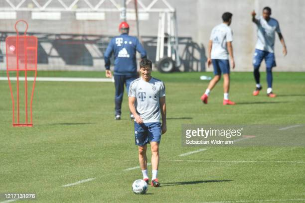 Robert Lewandowski of Bayern Muenchen smiles during a training session at Saebener Strasse training ground on April 06 2020 in Munich Germany