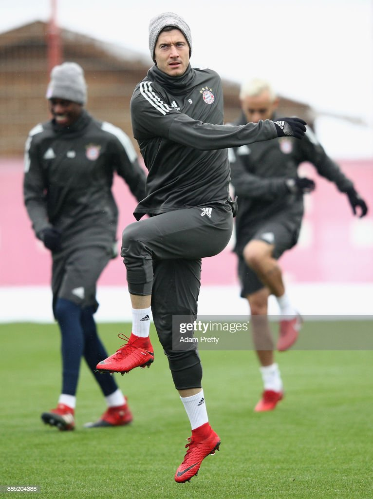 Robert Lewandowski of Bayern Muenchen warms up during a Bayern Muenchen training session on the eve of their UEFA Champions League match against PSG at Saebener Strasse training ground on December 4, 2017 in Munich, Germany.