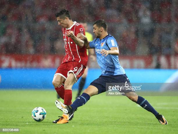 Robert Lewandowski of Bayern Muenchen with Aleksandar Dragovic of Bayer Leverkusen during the Bundesliga match between FC Bayern Muenchen and Bayer...