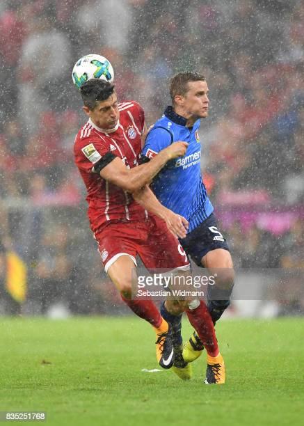 Robert Lewandowski of Bayern Muenchen with Sven Bender of Bayer Leverkusen during the Bundesliga match between FC Bayern Muenchen and Bayer 04...