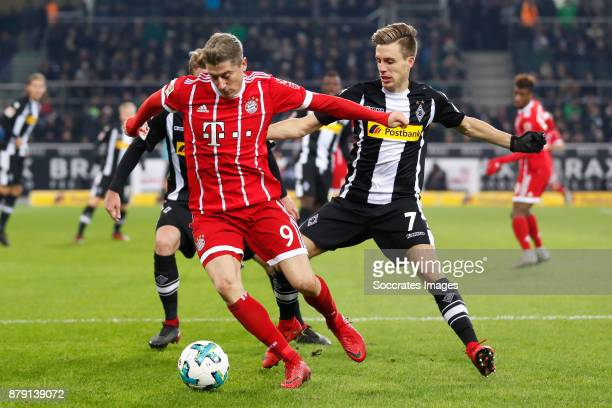 Robert Lewandowski of Bayern Munchen Patrick Hermann of Borussia Monchengladbach during the German Bundesliga match between Borussia Monchengladbach...