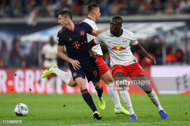 Robert Lewandowski of Bayern Munich and Ibrahima Konate of RB Leipzig battle for possession during the Bundesliga match between RB Leipzig and FC...