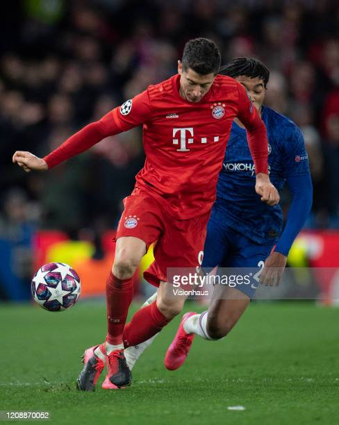 Robert Lewandowski of Bayern Munich and Reece James of Chelsea during the UEFA Champions League round of 16 first leg match between Chelsea FC and FC...