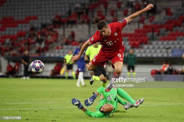 Robert Lewandowski of Bayern Munich battles for possession with Willy Caballero of Chelsea during the UEFA Champions League round of 16 second leg...