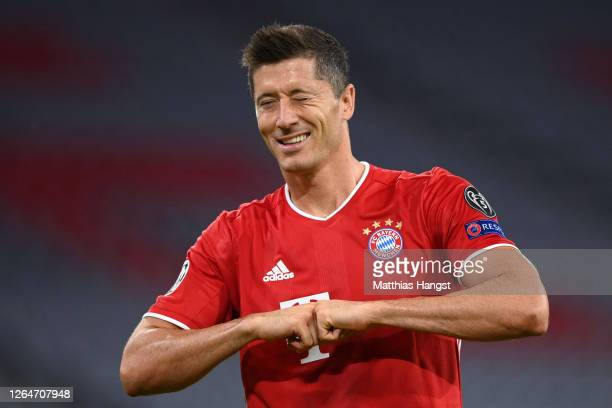 Robert Lewandowski of Bayern Munich celebrates after he scores his sides first goal from the penalty spot during the UEFA Champions League round of...