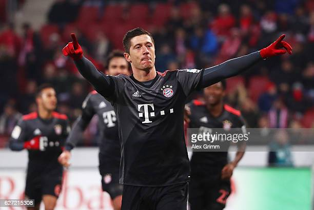 Robert Lewandowski of Bayern Munich celebrates after scoring a penalty goal during the Bundesliga match between 1 FSV Mainz 05 and Bayern Muenchen at...