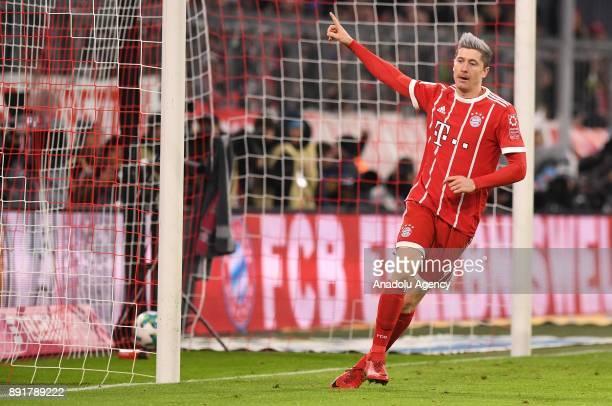 Robert Lewandowski of Bayern Munich celebrates after scoring a goal during the Bundesliga soccer match between FC Bayern Munich and 1 FC Cologne at...