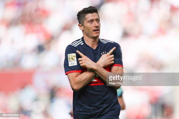 Robert Lewandowski of Bayern Munich celebrates after scoring a goal to make it 12 during the Bundesliga match between 1 FC Koeln and FC Bayern...