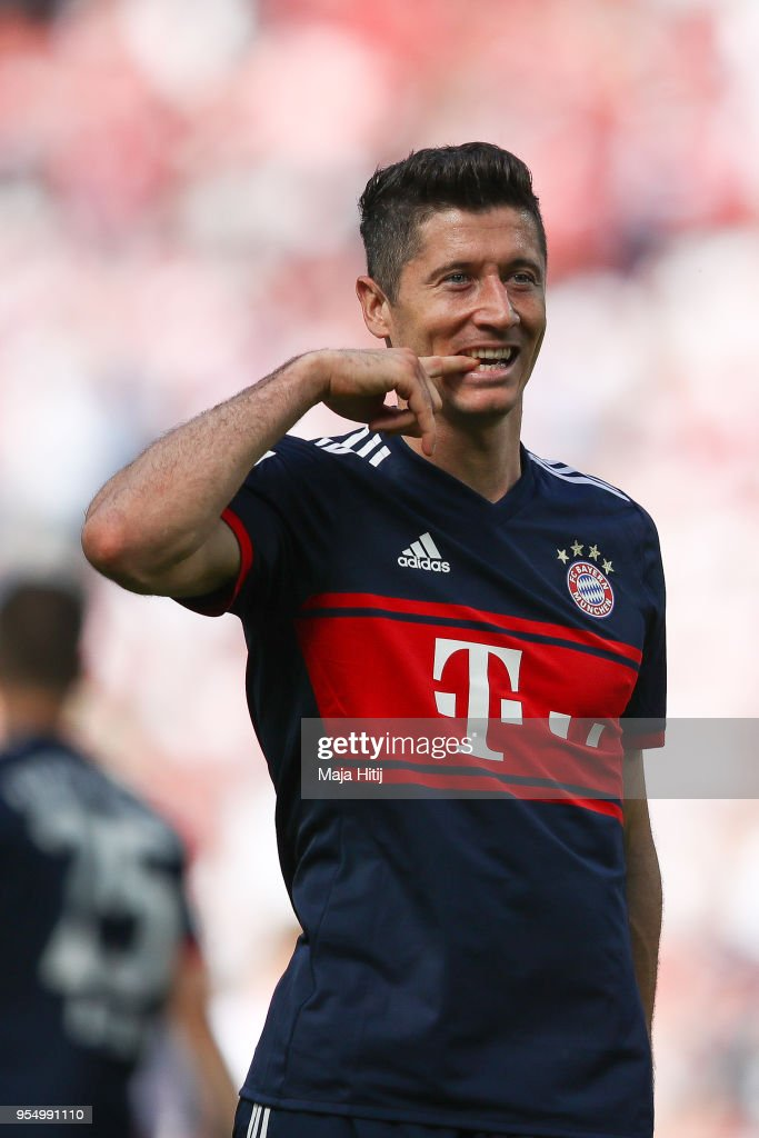 Robert Lewandowski #9 of Bayern Munich celebrates after scoring a goal to make it 1-2 during the Bundesliga match between 1. FC Koeln and FC Bayern Muenchen at RheinEnergieStadion on May 5, 2018 in Cologne, Germany.