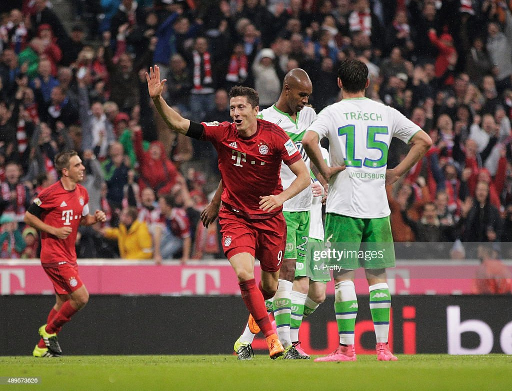 Robert Lewandowski of Bayern Munich celebrates after scoring his 5th goal during the Bundesliga match between FC Bayern Muenchen and VfL Wolfsburg at Allianz Arena on September 22, 2015 in Munich, Germany.
