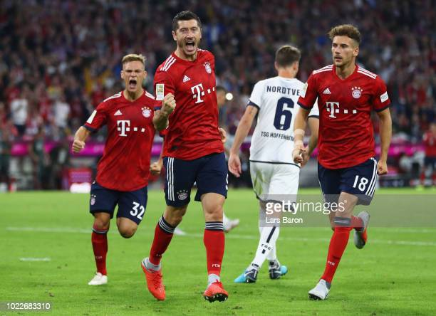 Robert Lewandowski of Bayern Munich celebrates after scoring his team's second goal from a penalty with team mates during the Bundesliga match...