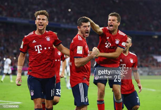Robert Lewandowski of Bayern Munich celebrates after scoring his team's second goal from a penalty with Leon Goretzka and Thomas Mueller during the...