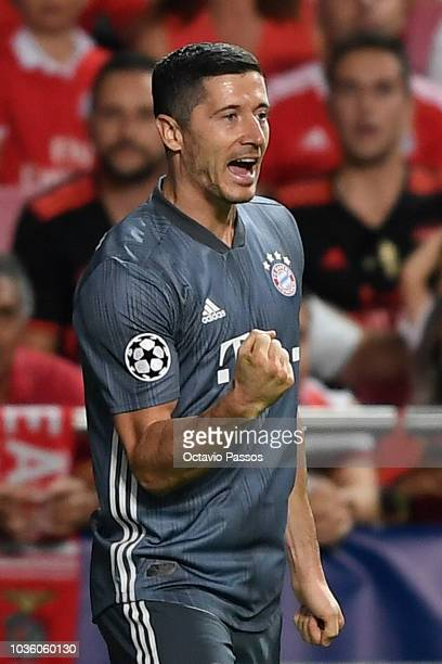 Robert Lewandowski of Bayern Munich celebrates after scoring his team's first goal during the Group E match of the UEFA Champions League between SL...