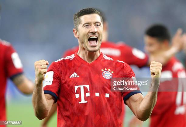 Robert Lewandowski of Bayern Munich celebrates after scoring his team's second goal during the Bundesliga match between FC Schalke 04 and FC Bayern...