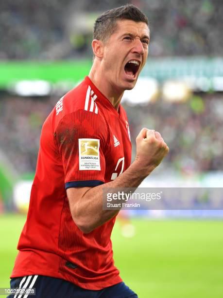 Robert Lewandowski of Bayern Munich celebrates after scoring his team's first goal during the Bundesliga match between VfL Wolfsburg and FC Bayern...