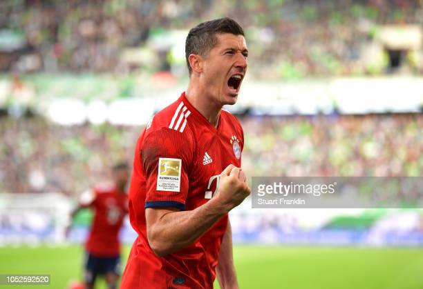 Robert Lewandowski of Bayern Munich celebrates after scoring his team's first goal during the Bundesliga match between VfL Wolfsburg and FC Bayern...