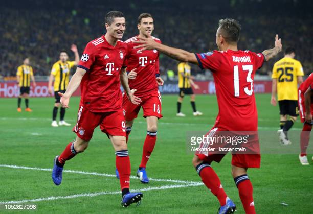 Robert Lewandowski of Bayern Munich celebrates after scoring his team's second goal with Rafinha of Bayern Munich during the Group E match of the...