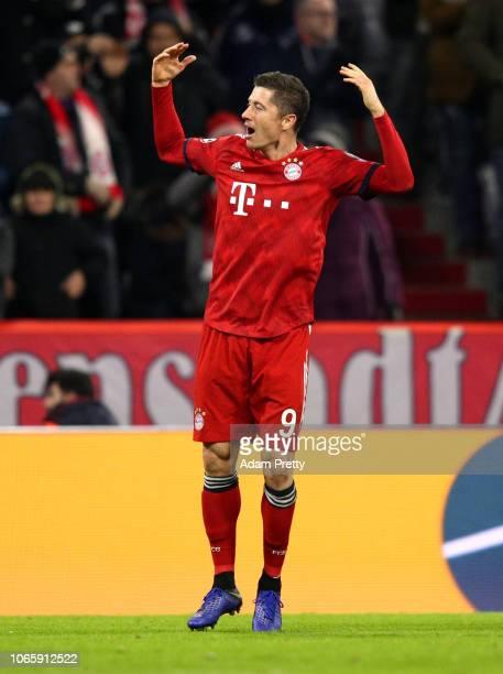 Robert Lewandowski of Bayern Munich celebrates after scoring his team's third goal during the UEFA Champions League Group E match between FC Bayern...