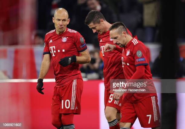 Robert Lewandowski of Bayern Munich celebrates after scoring his team's fourth goal with team mates Arjen Robben and Franck Ribery during the UEFA...