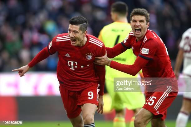 Robert Lewandowski of Bayern Munich celebrates after scoring his teams first goal with Thomas Mueller of Bayern Munich during the Bundesliga match...