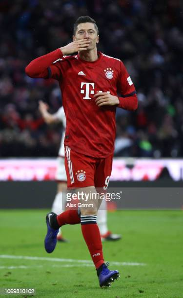 Robert Lewandowski of Bayern Munich celebrates after scoring his team's second goal during the Bundesliga match between FC Bayern Muenchen and 1 FC...