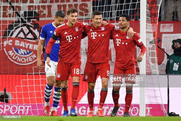 Robert Lewandowski of Bayern Munich celebrates after scoring his team's first goal with Leon Goretzka of Bayern Munich and Serge Gnabry of Bayern...