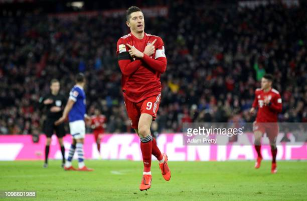 Robert Lewandowski of Bayern Munich celebrates after scoring his team's second goal during the Bundesliga match between FC Bayern Muenchen and FC...