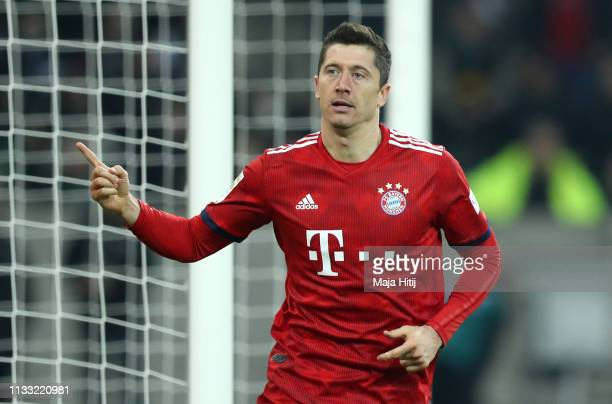 Robert Lewandowski of Bayern Munich celebrates after scoring his team's third goal during the Bundesliga match between Borussia Moenchengladbach and...