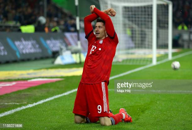 Robert Lewandowski of Bayern Munich celebrates after scoring his team's third goal during the Bundesliga match between Borussia Moenchengladbach and...