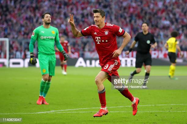 Robert Lewandowski of Bayern Munich celebrates after scoring his team's second goal during the Bundesliga match between FC Bayern Muenchen and...