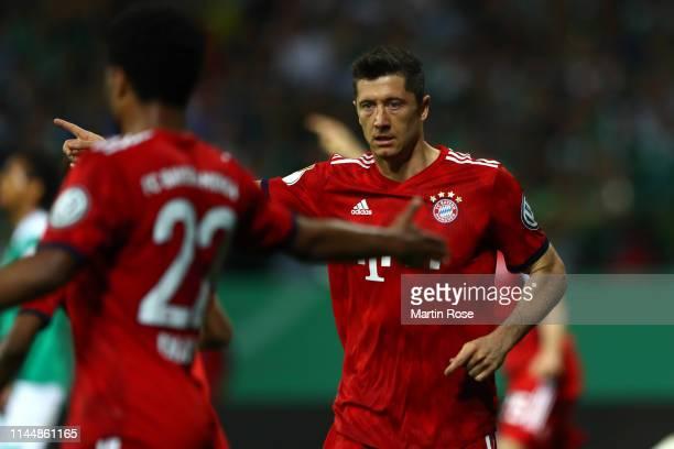 Robert Lewandowski of Bayern Munich celebrates after scoring his team's first goal during the DFB Cup semi final match between Werder Bremen and FC...