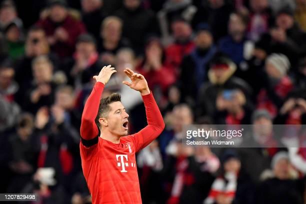 Robert Lewandowski of Bayern Munich celebrates after scoring his team's second goal during the Bundesliga match between FC Bayern Muenchen and SC...