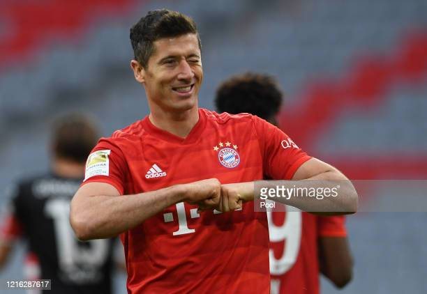 Robert Lewandowski of Bayern Munich celebrates after scoring his team's fourth goal during the Bundesliga match between FC Bayern Muenchen and...
