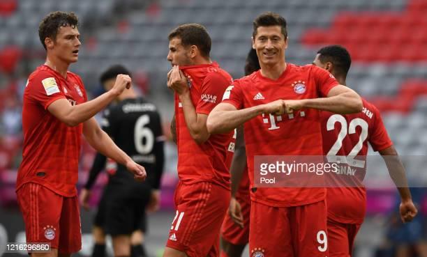 Robert Lewandowski of Bayern Munich celebrates after scoring his team's third goal during the Bundesliga match between FC Bayern Muenchen and Fortuna...