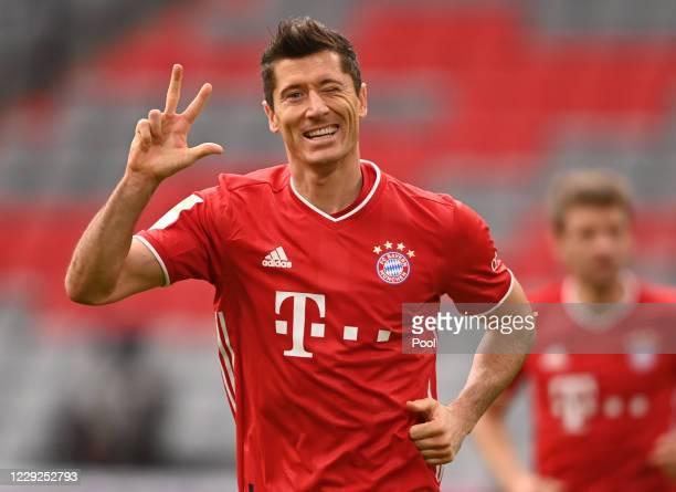 Robert Lewandowski of Bayern Munich celebrates after scoring his sides third goal during the Bundesliga match between FC Bayern Muenchen and...
