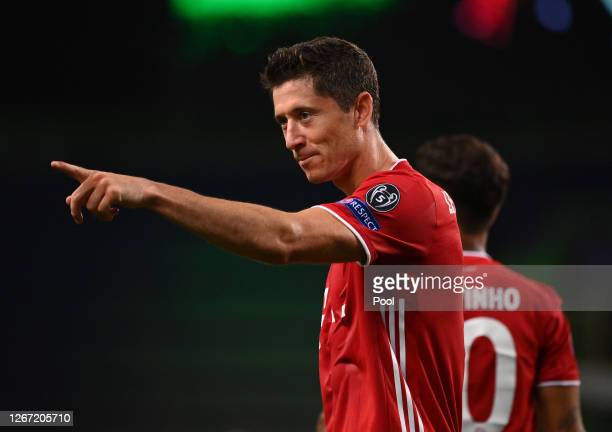 Robert Lewandowski of Bayern Munich celebrates after scoring his team's third goal during the UEFA Champions League Semi Final match between...