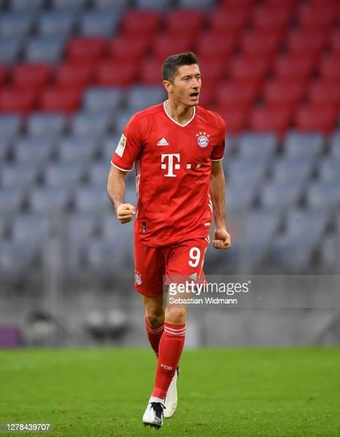 Robert Lewandowski of Bayern Munich celebrates after scoring his team's first goal during the Bundesliga match between FC Bayern Muenchen and Hertha...