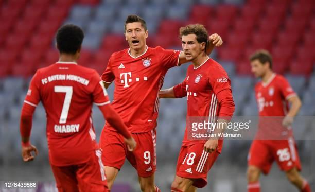Robert Lewandowski of Bayern Munich celebrates after scoring his team's first goal with teammates Leon Goretzka and Serge Gnabry during the...