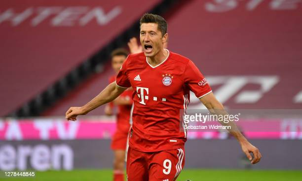 Robert Lewandowski of Bayern Munich celebrates after scoring his team's third goal during the Bundesliga match between FC Bayern Muenchen and Hertha...
