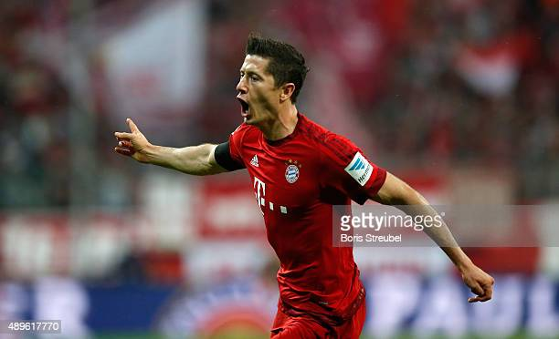 Robert Lewandowski of Bayern Munich celebrates after scoring his second goal during the Bundesliga match between FC Bayern Muenchen and VfL Wolfsburg...