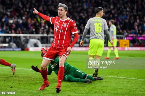 Robert Lewandowski of Bayern Munich celebrates after scoring his team's first to make it 10 during the Bundesliga match between FC Bayern Muenchen...