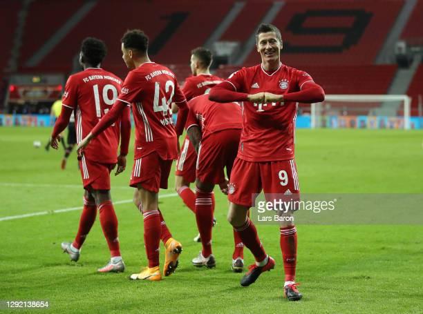 Robert Lewandowski of Bayern Munich celebrates after scoring their team's second goal during the Bundesliga match between Bayer 04 Leverkusen and FC...