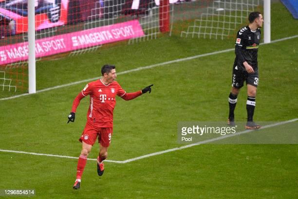 Robert Lewandowski of Bayern Munich celebrates after scoring their team's first goal during the Bundesliga match between FC Bayern Muenchen and...