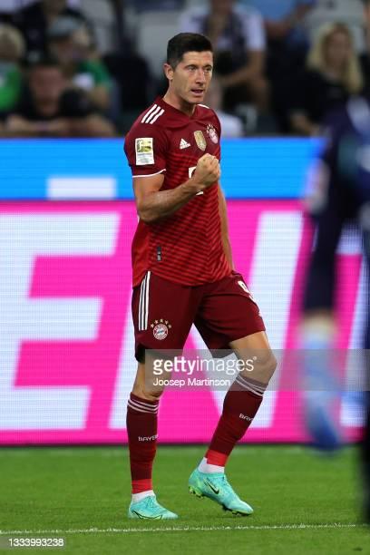 Robert Lewandowski of Bayern Munich celebrates after scoring their side's first goal during the Bundesliga match between Borussia Monchengladbach and...