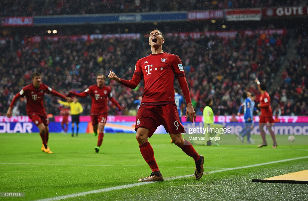 Robert Lewandowski of Bayern Munich celebrates as he scores his and the team's second goal during the Bundesliga match between FC Bayern Muenchen and 1899 Hoffenheim at Allianz Arena on January 31, 2016 in Munich, Germany.