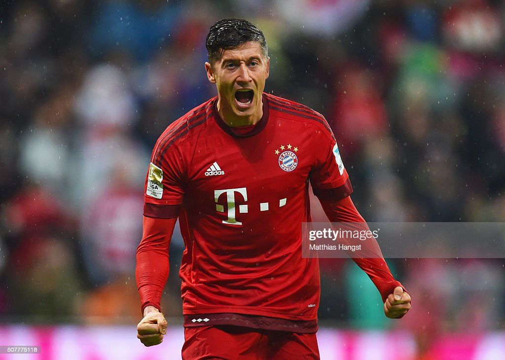 Robert Lewandowski of Bayern Munich celebrates as he scores their first goal during the Bundesliga match between FC Bayern Muenchen and 1899 Hoffenheim at Allianz Arena on January 31, 2016 in Munich, Germany.