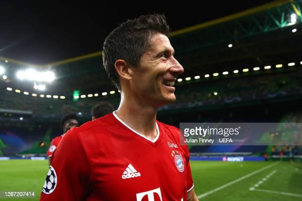 Robert Lewandowski of Bayern Munich celebrates following his sides victory in the UEFA Champions League Semi Final match between Olympique Lyonnais...